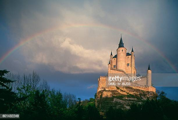 Cloudy sky and rainbow over the Alcazar of Segovia Castile and Leon Spain 11th19th century