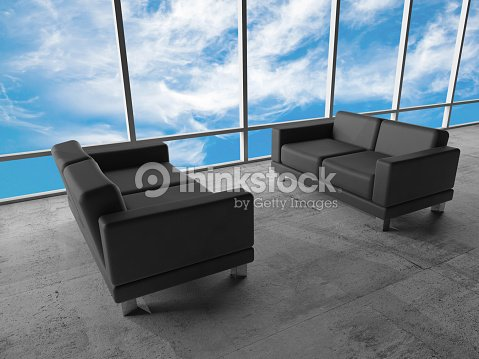 Cloudy Sky And Two Black Leather Sofas Stock Photo