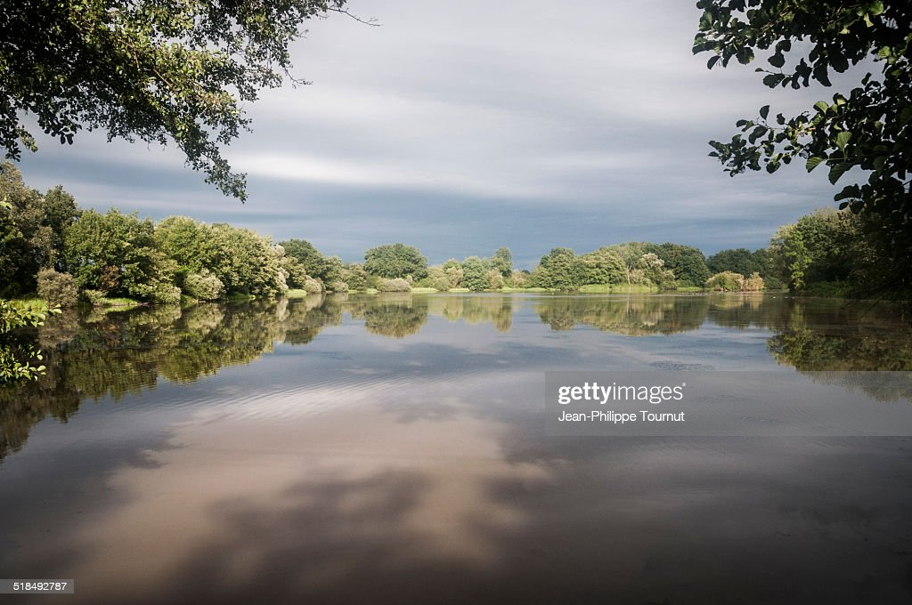 Cloudy sky on a Pond in Bourgogne, France