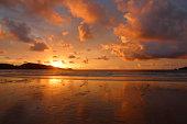 Cloudy sky over beach at sunset