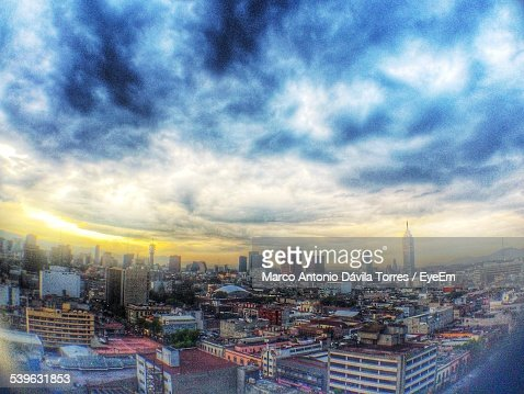 Cloudy Sky Over City At Sunset