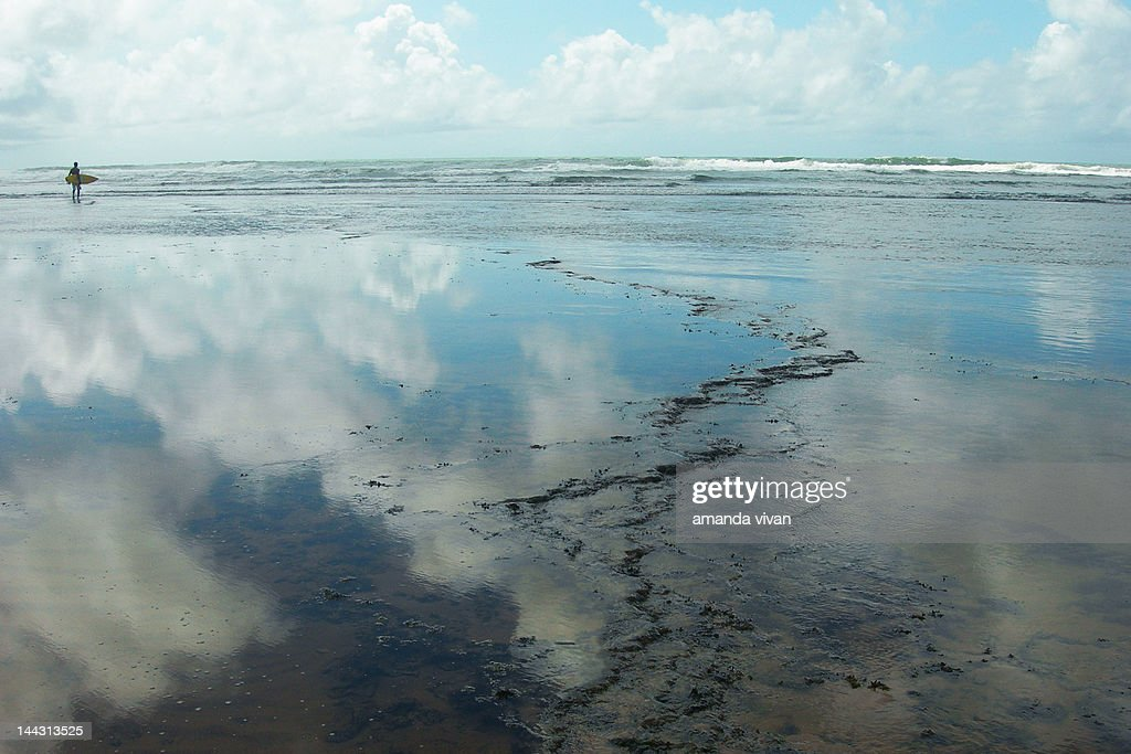 Cloudy sky reflection in water : Stock Photo