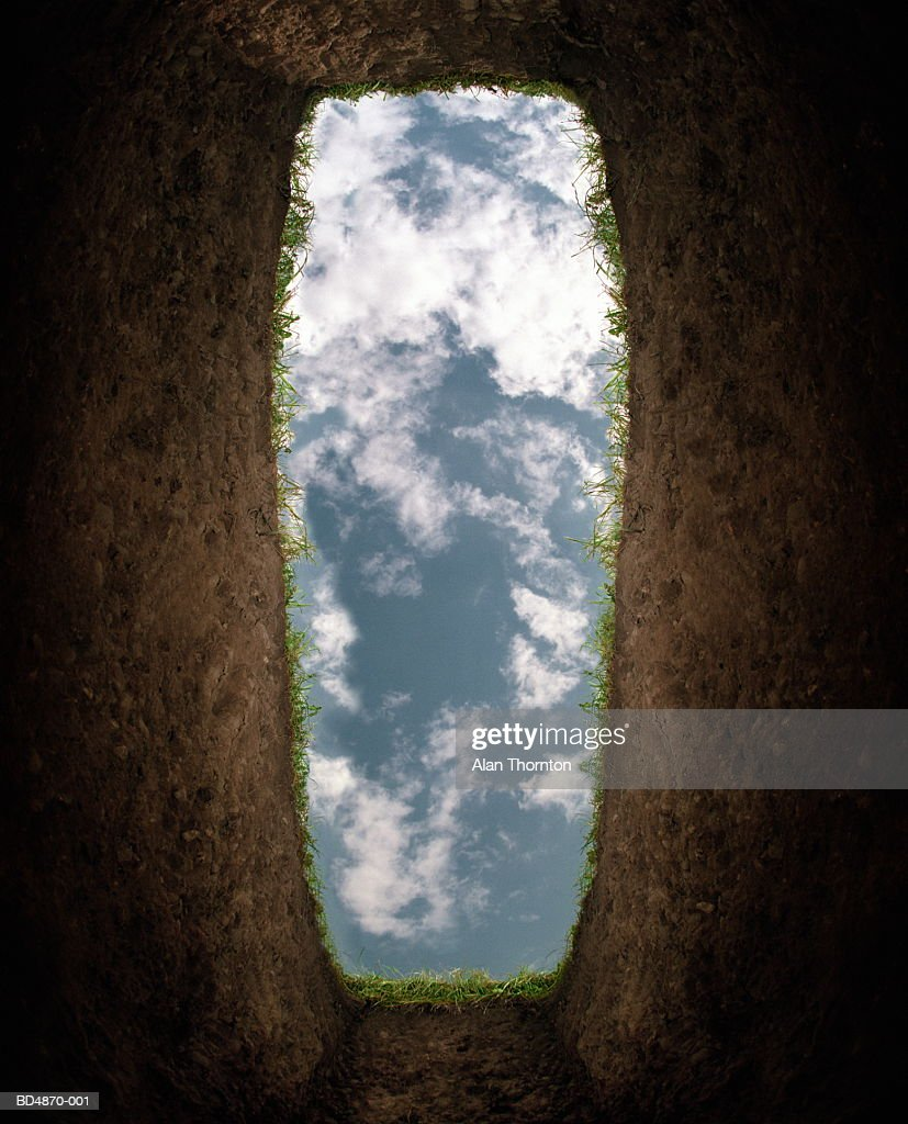 Cloudy sky seen from bottom of grave (Digital Enhancement)