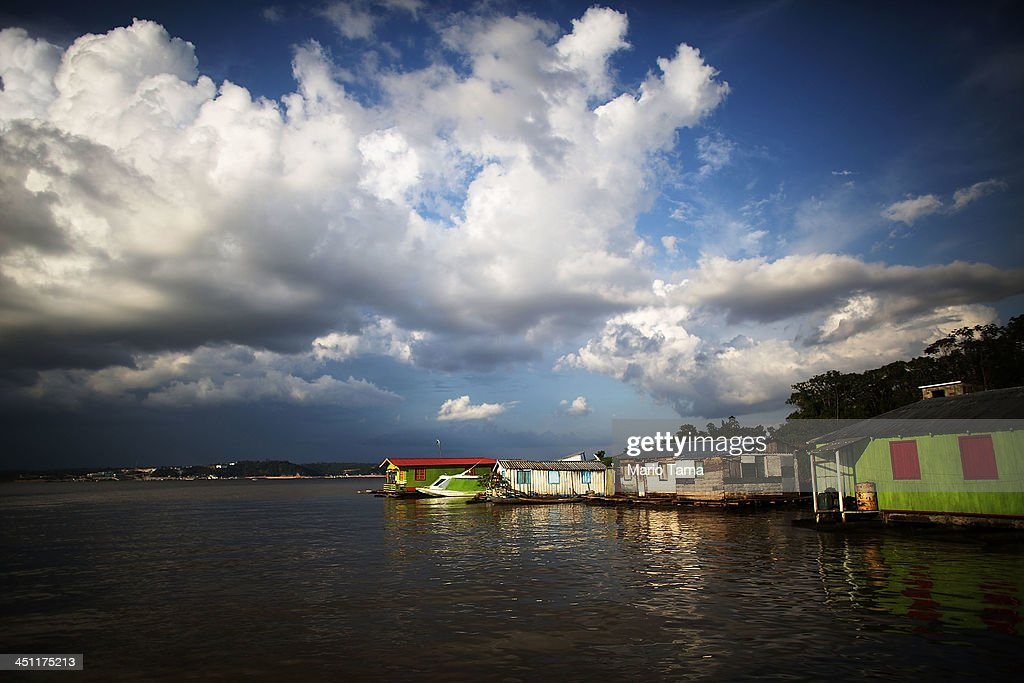 Clousa hand above one of many floating villages along Rio Negro on November 21 2013 in Manaus Brazil Manaus' Arena Amazonia will be a stadium venue...