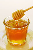 Clover honey in jam jar with dipper