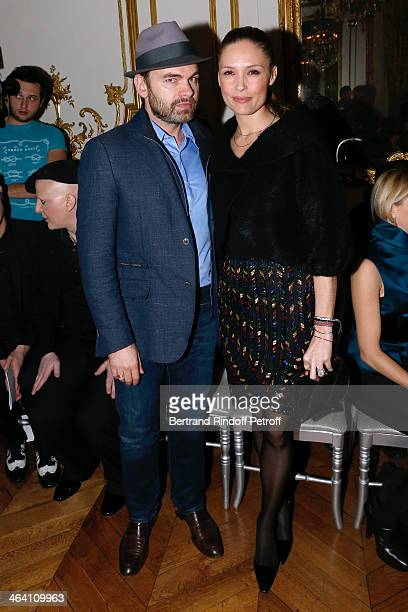 Clovis Cornillac and his wife Lilou Fogli attend the Alexis Mabille show as part of Paris Fashion Week Haute Couture Spring/Summer 2014 on January 20...