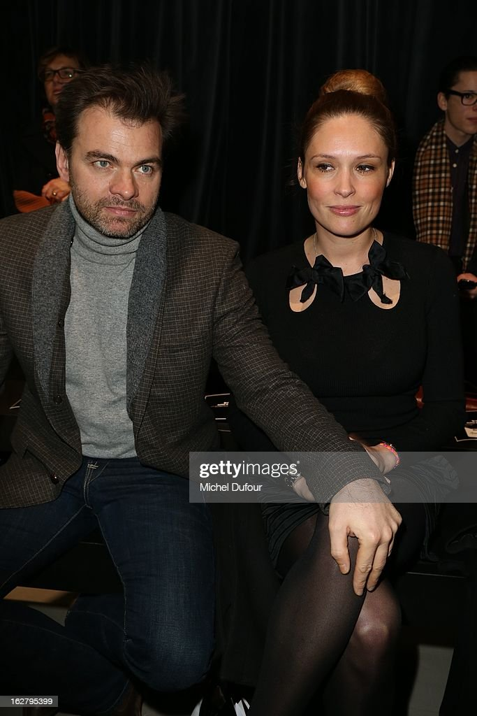 Clovis Cornillac and Lilou Fogli attend the Alexis Mabille Fall/Winter 2013 Ready-to-Wear show as part of Paris Fashion Week on February 27, 2013 in Paris, France.