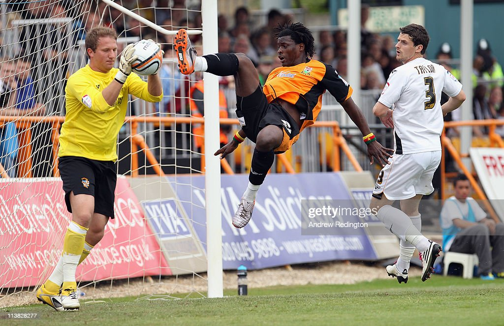 Clovis Kamdjo of Barnet challenges Port Vale's goalkeeper Chris Martin during the npower League Two match between Barnet and Port Vale at Underhill Stadium on May 7, 2011 in Barnet, England.