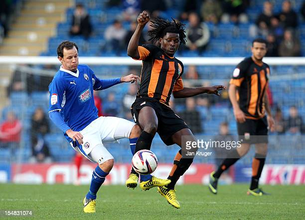 Clovis Kamdjo of Barnet FC battles with Sam Togwell of Chesterfield during the npower League Two match between Chesterfield and Barnet at Proact...