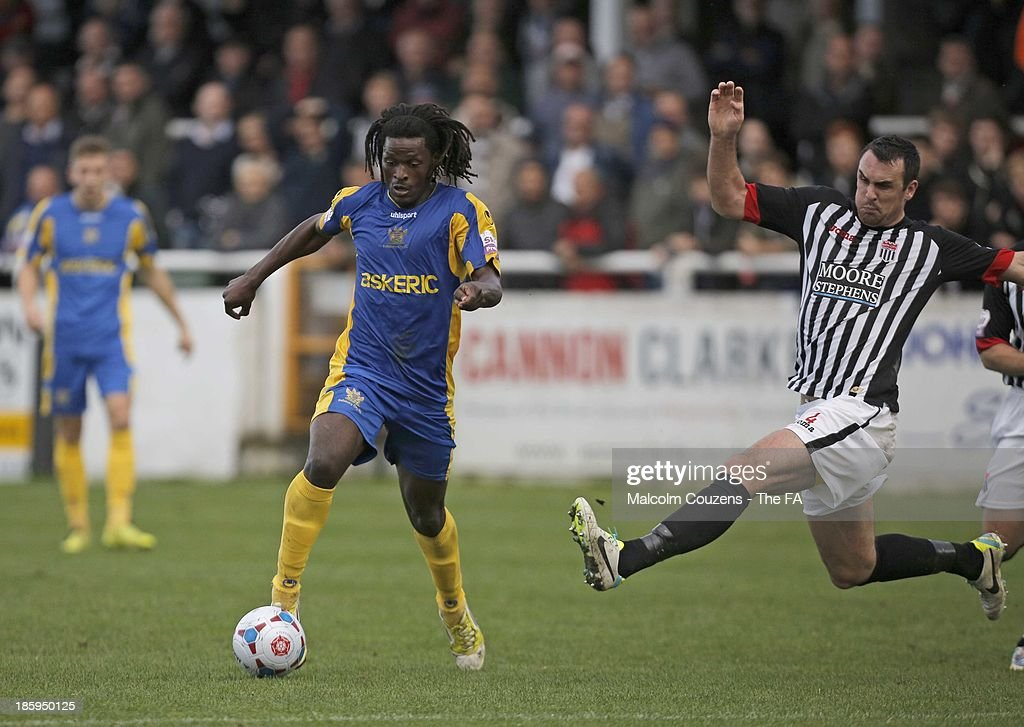 Clovis Kamdjo of Salisbury (L) in aciton against Mark Preece of Bath City during the FA Cup fourth qualifying round match between Bath City and Salisbury at Twerton Park on October 26, 2013 in Bath, England.