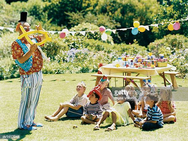 A Clown Amuses a Medium Group of Children at a Birthday Party