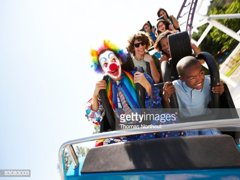 clown and people on a roller coaster