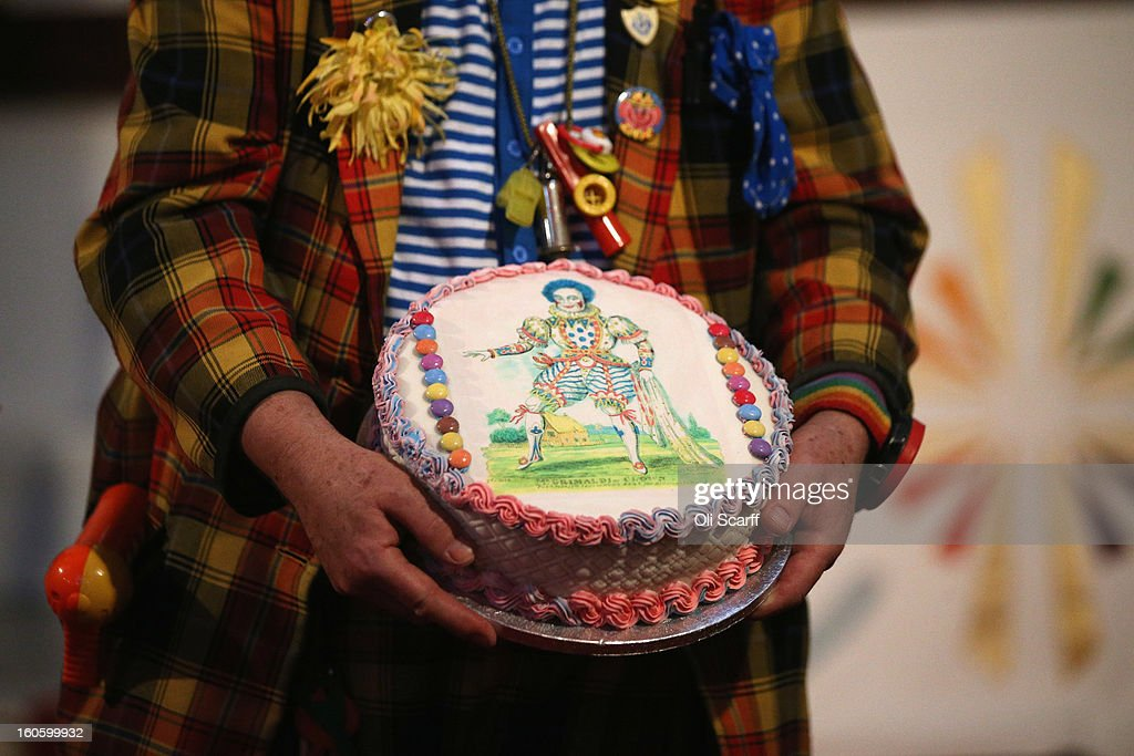 A clown carries a cake during the annual Clowns Church Service at Holy Trinity Church in Dalston on February 3, 2013 in London, England. Clowns attend the service in memory of Joseph Grimaldi (1778-1837), the most celebrated English clown who was born in London. The service has been an annual tradition since 1946 with the attending clowns usually performing for the public afterwards.