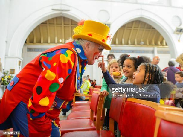 A clown entertains children the annual service in memory of celebrated clown Joseph Grimaldi at the Holy Trinity Church in Dalston east London