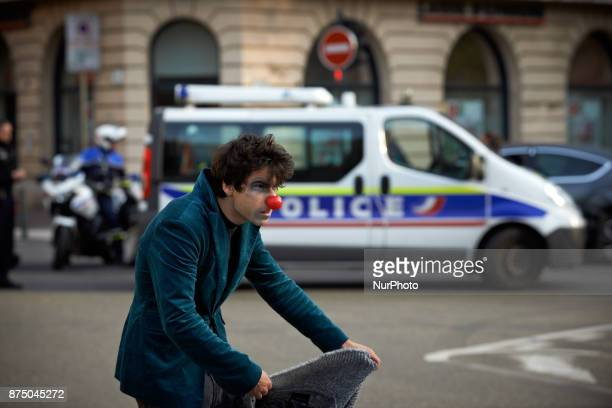 A clown gestures near a police van at the end of the demonstration More than 4000 protesters took to the streets of Toulouse against the new Macron's...