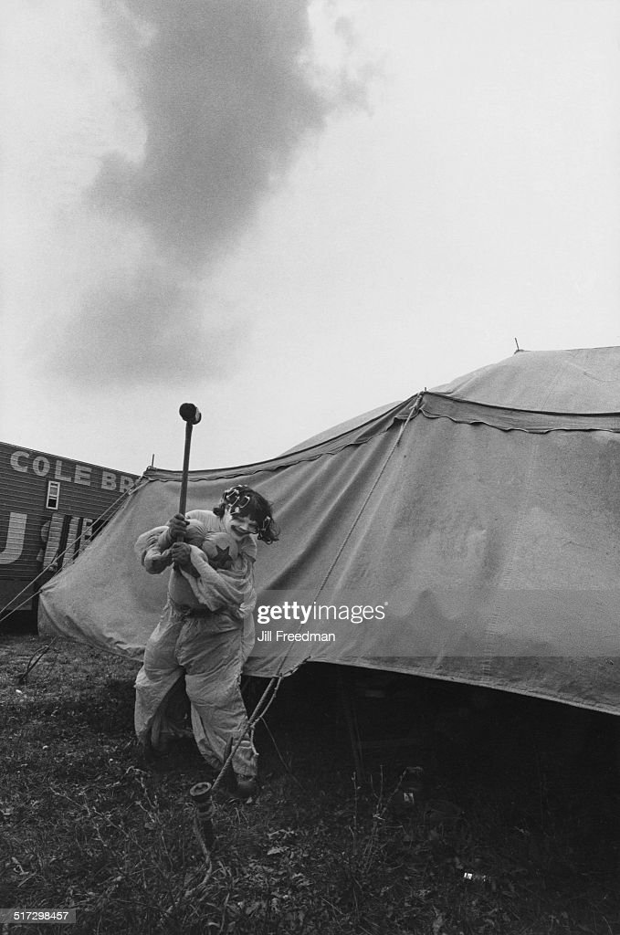 A clown hammers a tent peg at the Clyde BeattyCole Bros Circus show USA 1971