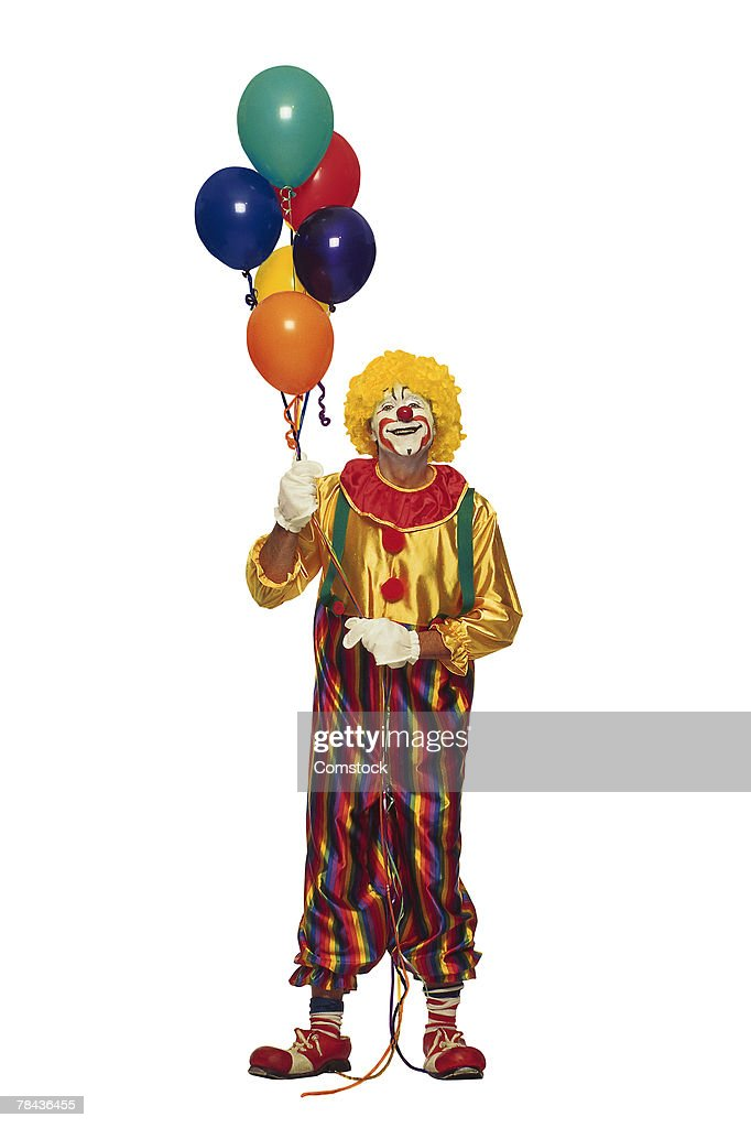 Clown holding balloons