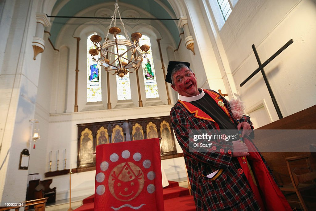 A clown in full costume attends the annual Clowns Church Service at Holy Trinity Church in Dalston on February 3, 2013 in London, England. Clowns attend the service in memory of Joseph Grimaldi (1778-1837), the most celebrated English clown who was born in London. The service has been an annual tradition since 1946 with the attending clowns usually performing for the public afterwards.