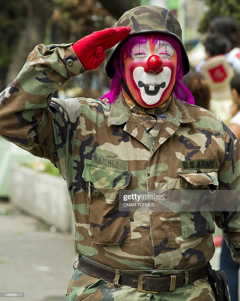 A clown in military clothes salutes as he takes part in the pilgrimage to the Virgin of Guadalupe's basilica, Mexico's patron saint, in Mexico City on July 18, 2012. Hundreds of clowns take part in the annual pilgrimage to the sanctuary of the Virgin. AFP PHOTO/Omar Torres
