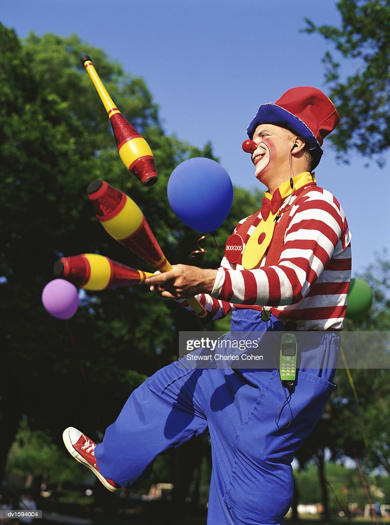 Clown Juggling in a Park : Stock Photo