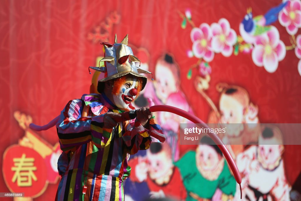 A clown performs at the Spring Festival Temple Fair for celebrating Chinese Lunar New Year of Horse at the Temple of Earth park on January 30, 2014 in Beijing, China. The Chinese Lunar New Year of Horse also known as the Spring Festival, which is based on the Lunisolar Chinese calendar, is celebrated from the first day of the first month of the lunar year and ends with Lantern Festival on the Fifteenth day.