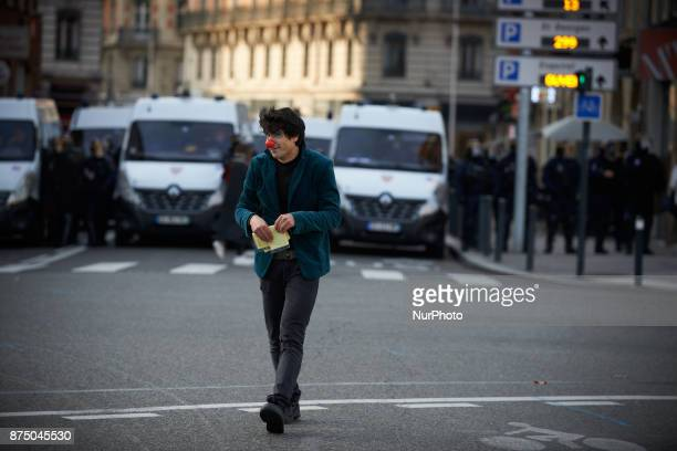 A clown plays in front of riot police More than 4000 protesters took to the streets of Toulouse against the new Macron's reforms on the Work Code and...