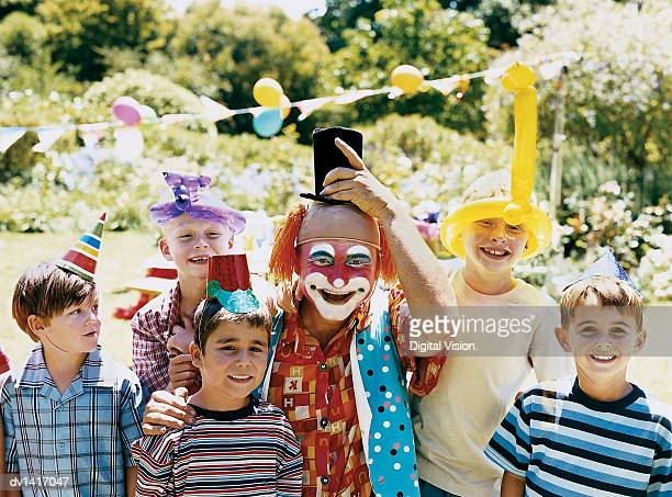 A Clown Posing with Boys at a Birthday Party in a Garden