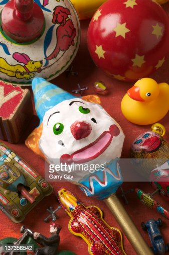Clown rattle with old toys : Stock Photo