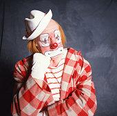 Clown resting chin on fist, portrait