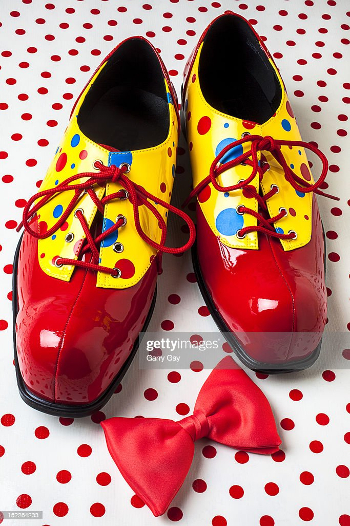 Clown shoes and a red bow tie : Stock Photo