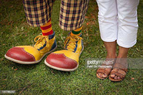 Clown shoes and open sandals