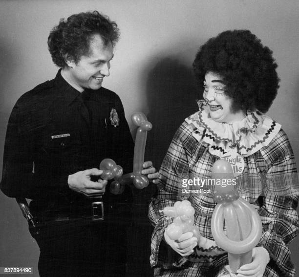 Clown shows Officer the art of making balloon animals Officer Michael Haan is instructed by JB Sallers who believes the art helps policemen put lost...