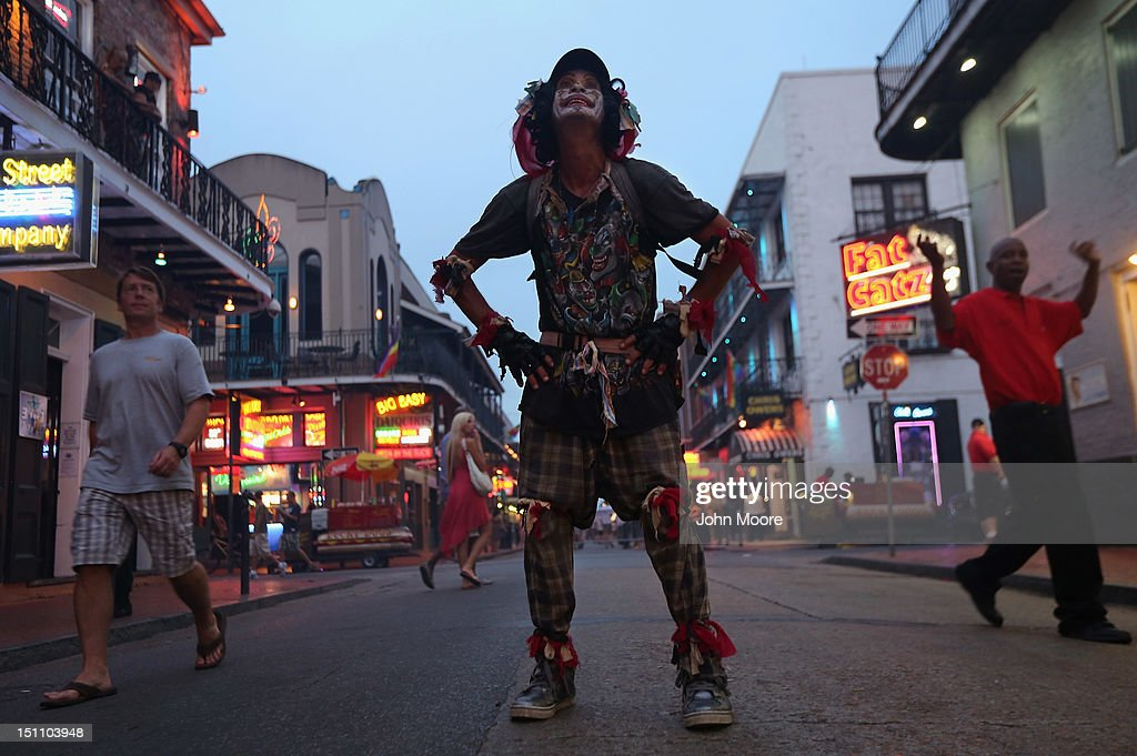 A clown stands on Bourbon Street on August 31, 2012 in the French Quarter of New Orleans, Louisiana. The French Quarter, Louisiana's most popular tourist attraction, returned to it's usual state of revelry, even as much of New Orleans was still without electricity, three days after Hurricane Isaac knocked out power to hundreds of thousands of people.