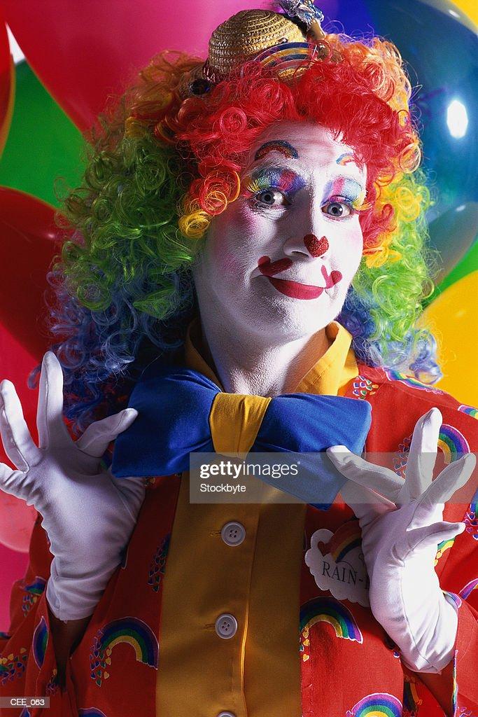 Clown straightening oversized bow tie : Stock Photo