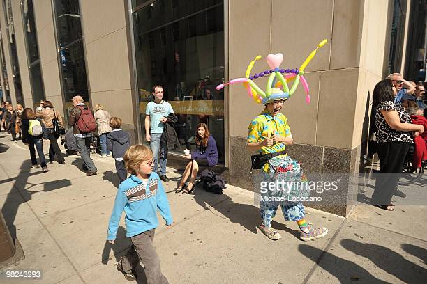 A clown that makes balloonanimal hats takes part in the annual Easter Parade bonnet and costumewearing festivities on April 4 2010 in New York City...