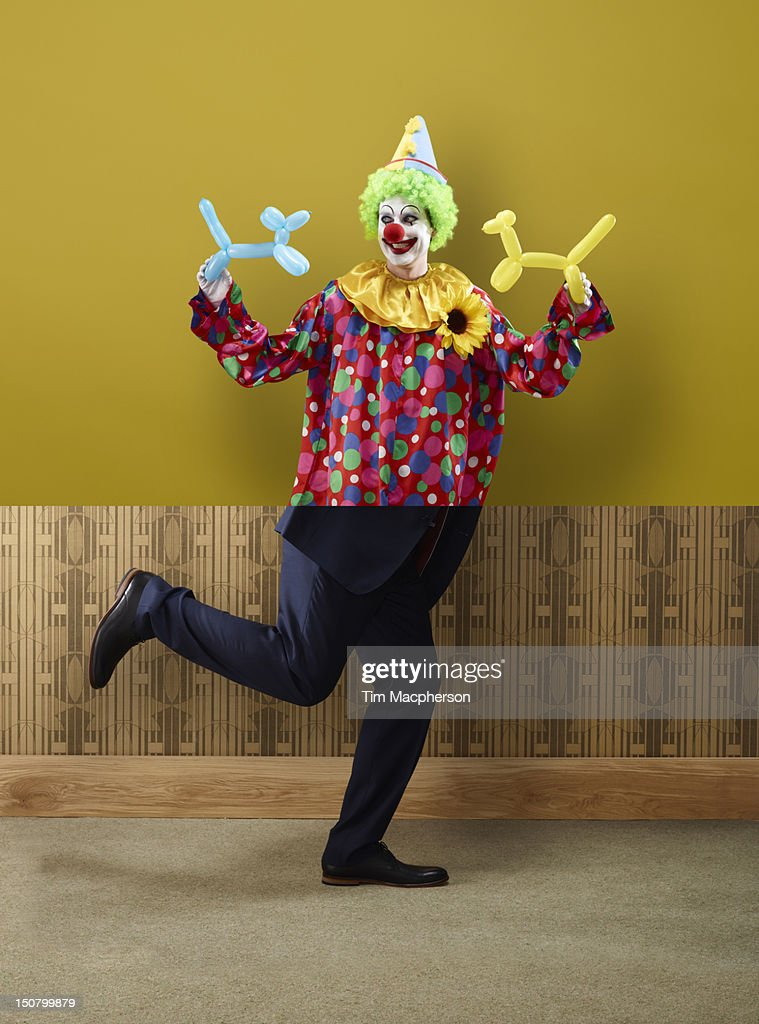 Clown top, business man bottom : Stock Photo