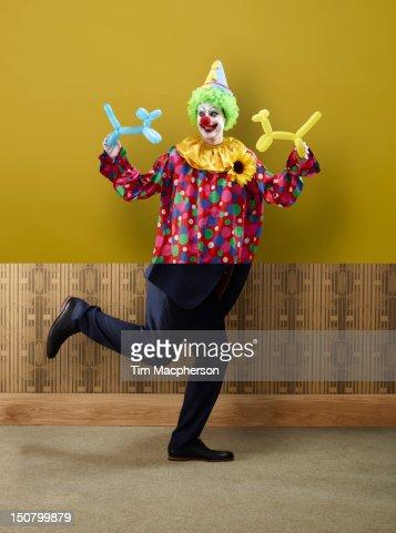 Clown top, business man bottom : Stockfoto