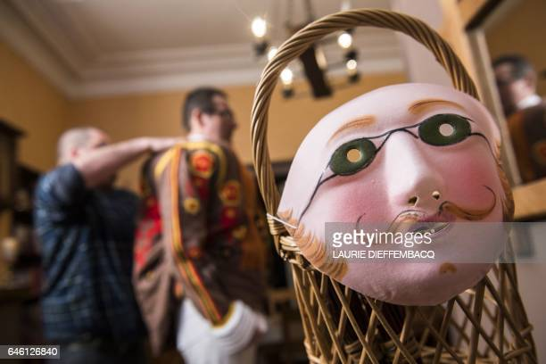 Clownlike performers known as Gilles prepare themselves before taking part in a carnival parade in the Belgian town of Binche on February 28 2017 The...