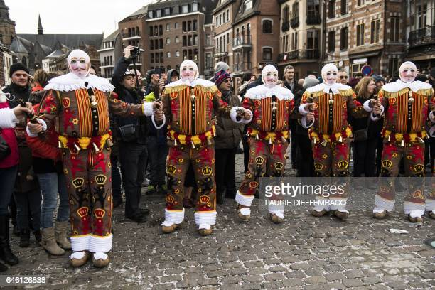 Clownlike performers known as Gilles take part in a carnival parade in the Belgian town of Binche on February 28 2017 The Binche Carnival tradition...