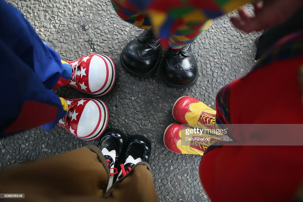 Clowns arrive ahead of the 70th anniversary Clown Church Service at All Saints Church in Haggerston on February 7, 2016 in London, England. Clowns attended the service in memory of Joseph Grimaldi (1778-1837), the most celebrated English clown who was born in London. The service has been an annual tradition since 1946.