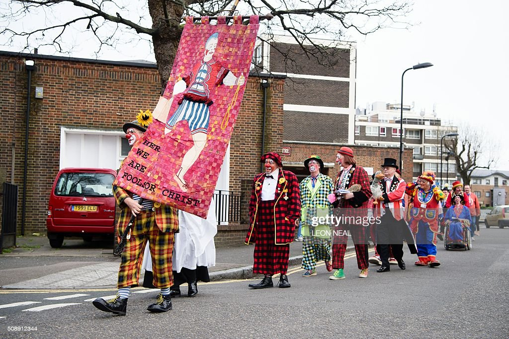Clowns arrive for the 70th annual 'Clowns International' church service at the Holy Trinity church in Dalston in east London, England on February 7, 2016. The service takes place to celebrate the father of modern clowning, Joseph Grimaldi, who died in 1837. / AFP / LEON NEAL