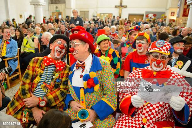 Clowns attend the annual service in memory of celebrated clown Joseph Grimaldi at the Holy Trinity Church in Dalston east London
