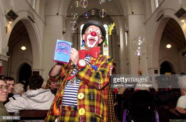 Clowns from across the United Kingdom form part of the congregation for the 58th Annual Grimaldi Service at the 'Clown's Church' in Dalston east...