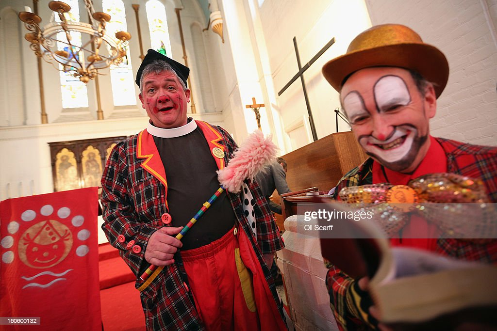 Clowns in full costume attend the annual Clowns Church Service at Holy Trinity Church in Dalston on February 3, 2013 in London, England. Clowns attend the service in memory of Joseph Grimaldi (1778-1837), the most celebrated English clown who was born in London. The service has been an annual tradition since 1946 with the attending clowns usually performing for the public afterwards.