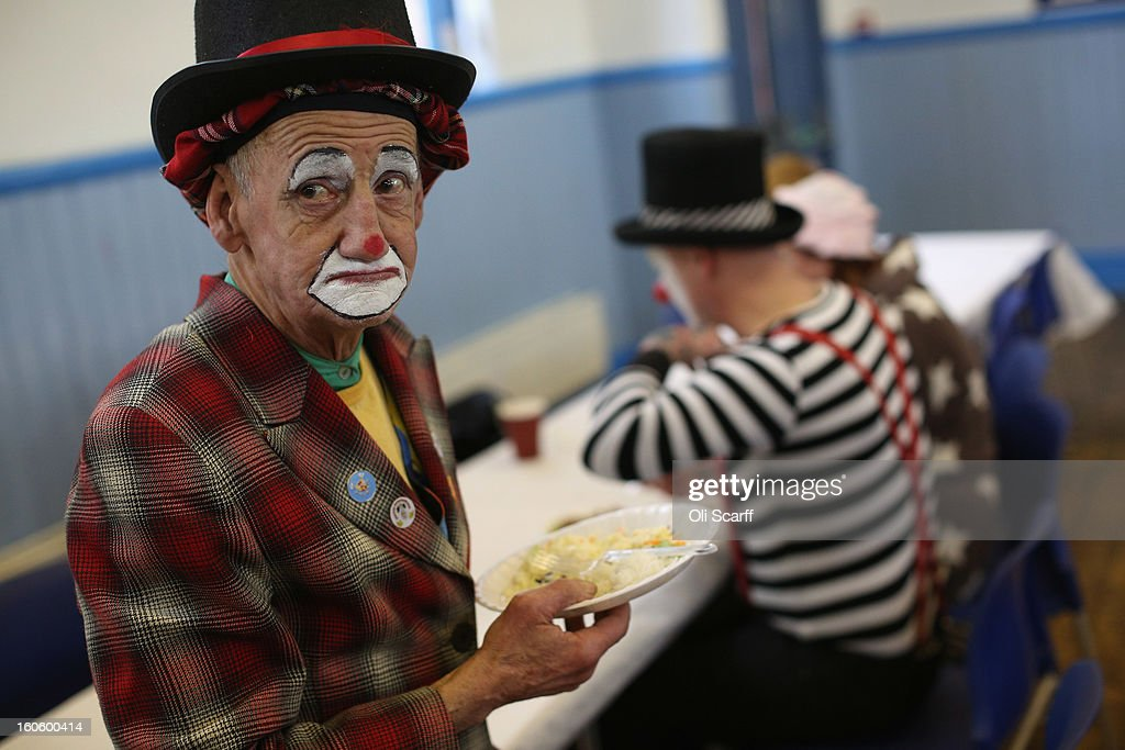 Clowns in full costume have a meal before attending the annual Clowns Church Service at Holy Trinity Church in Dalston on February 3, 2013 in London, England. Clowns attend the service in memory of Joseph Grimaldi (1778-1837), the most celebrated English clown who was born in London. The service has been an annual tradition since 1946 with the attending clowns usually performing for the public afterwards.
