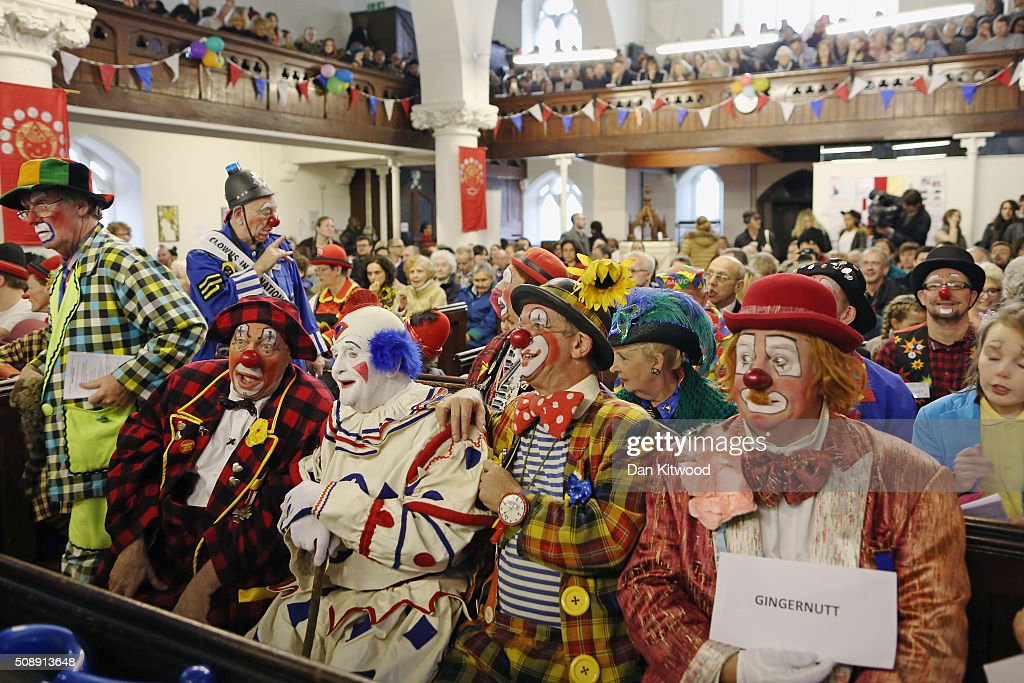 Clowns including English actor, musician, writer, and theatre director <a gi-track='captionPersonalityLinkClicked' href=/galleries/search?phrase=Simon+Callow&family=editorial&specificpeople=234849 ng-click='$event.stopPropagation()'>Simon Callow</a> CBE (at left) (who made a surprise appearance) attend the 70th anniversary Clown Church Service at All Saints Church in Haggerston on February 7, 2016 in London, England. Clowns attended the service in memory of Joseph Grimaldi (1778-1837), the most celebrated English clown who was born in London. The service has been an annual tradition since 1946.