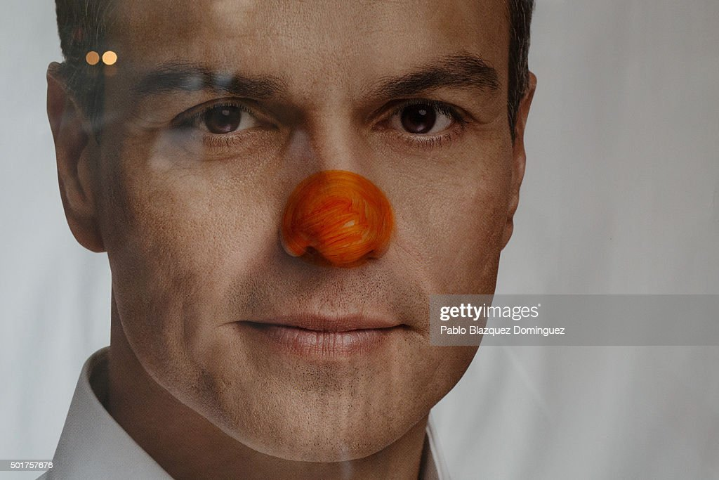 A clown's nose is painted over a poster of Partido Socialista Obrero Espanol PSOE leader Pedro Sanchez at a bus stop on December 17 2015 in Parla...