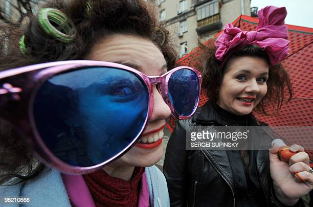 Clowns perform during their traditional march through central Kiev to mark April Fool's Day on April 1 2010 AFP PHOTO/ SERGEI SUPINSKY