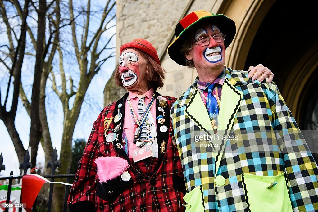 Clowns pose ahead of the 70th annual 'Clowns International' church service at the Holy Trinity church in Dalston in east London, England on February 7, 2016. The service takes place to celebrate the father of modern clowning, Joseph Grimaldi, who died in 1837. / AFP / LEON NEAL