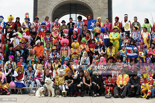 Clowns poses for their photo during the third day of the XX Convention of Clowns at the Monumento a la Revolucion in Mexico City on October 21 2015...